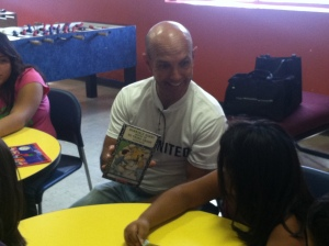 United Way Board member Oscar Garza of Johnson & Johnson reads at the Boys and Girls Club Petty